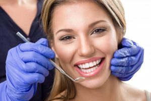 woman smiling dentist visit